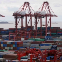 Containers at the Yangshan deep-water port in Shanghai | REUTERS