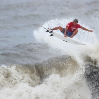 Japan's Kanoa Igarashi rode to the podium in the first-ever Olympic surfing competition Tuesday, securing a silver medal behind Brazil's Italo Ferreira. Japan's Amuro Tsuzuki took bronze in the women's competition.    REUTERS