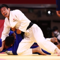 Takanori Nagase of Japan reacts after winning gold against Saeid Mollaei of Mongolia on Tuesday at Nippon Budokan.  | REUTERS
