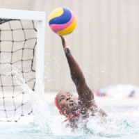 U.S. women's water polo team goalie Ashleigh Johnson tips a ball during training in California in June. | MICHAEL OWENS / THE NEW YORK TIMES