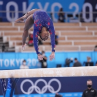 Simone Biles of the United States competes on the balance beam in Tokyo on July 25. | CHANG W. LEE / THE NEW YORK TIMES