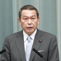 Hachiro Okonogi speaks as chairman of the National Public Safety Commission to reporters at the Prime Minister's Office in September of last year. | KYODO