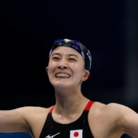 Japan's Yui Ohashi celebrates after winning the Olympic final of the women's 200-meter individual medley on Wednesday at Tokyo Aquatics Centre.    AFP-JIJI