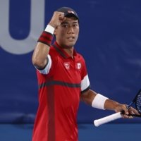 Kei Nishikori celebrates after winning his second-round match against Marcos Giron of the United States.  | REUTERS