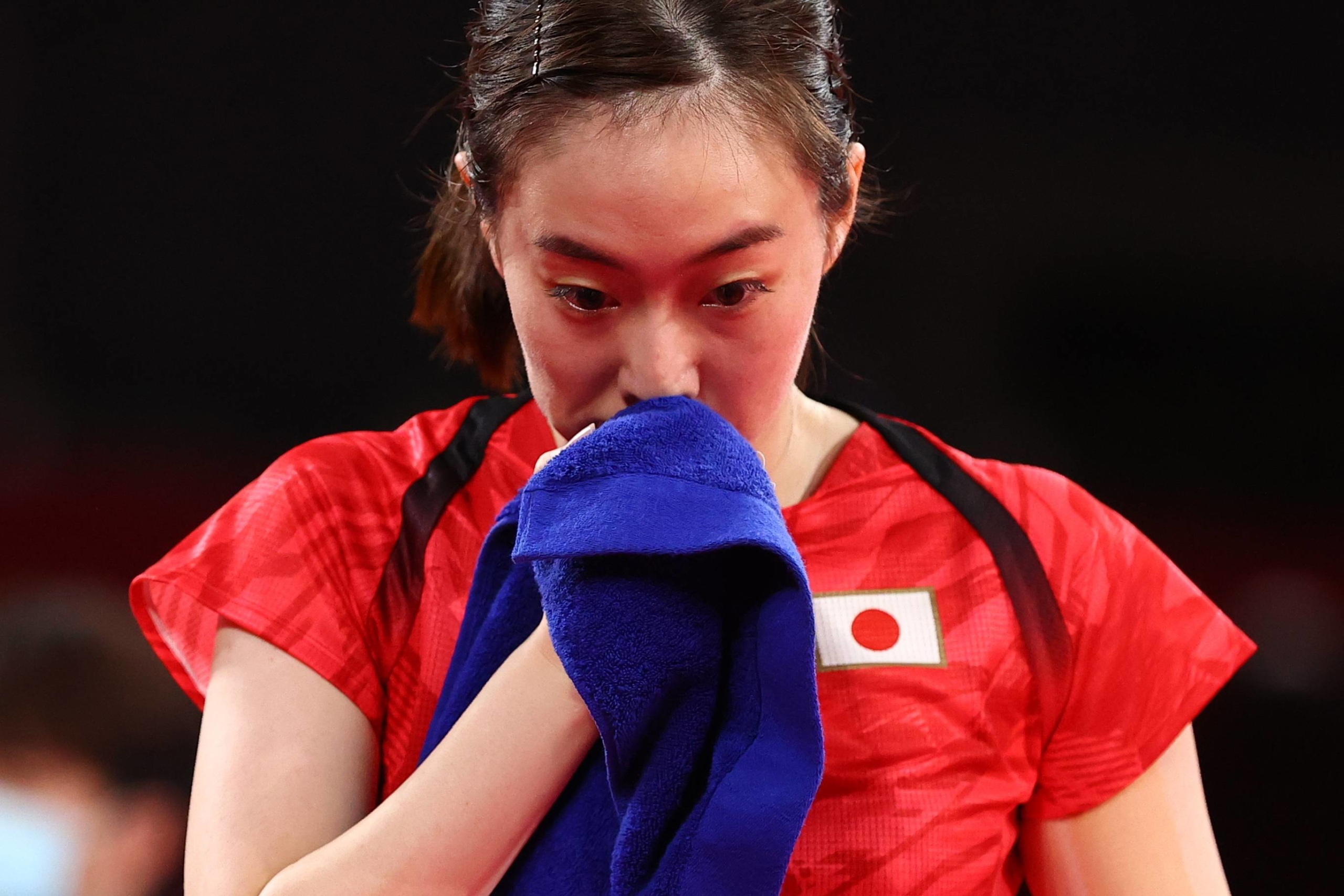 Kasumi Ishikawa of Japan reacts after being defeated by Yu Mengyu of Singapore in the women's table tennis singles quarterfinals.    REUTERS