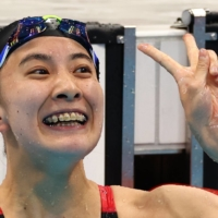 Japan's Yui Ohashi celebrates after winning gold in the women's 200-meter individual medley.    REUTERS
