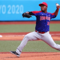 Cristopher Mercedes of the Dominican Republic shut Japan's powerful lineup down over six innings.    REUTERS