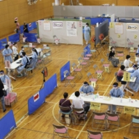 A group inoculation for junior high school students in Soma, Fukushima Prefecture, on Tuesday   KYODO