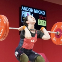 Ando lifted 120 kg in her final jerk attempt Tuesday to clinch the bronze medal. | KYODO