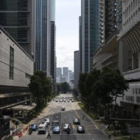 A near-empty Shenton Way in the central business district of Singapore on Monday.   BLOOMBERG