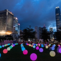 A light show marks the centenary of the Chinese Community Party and the anniversary of Hong Kong's return to Chinese rule at Tamar Park in Hong Kong, China, on Thursday, July 1. | BLOOMBERG