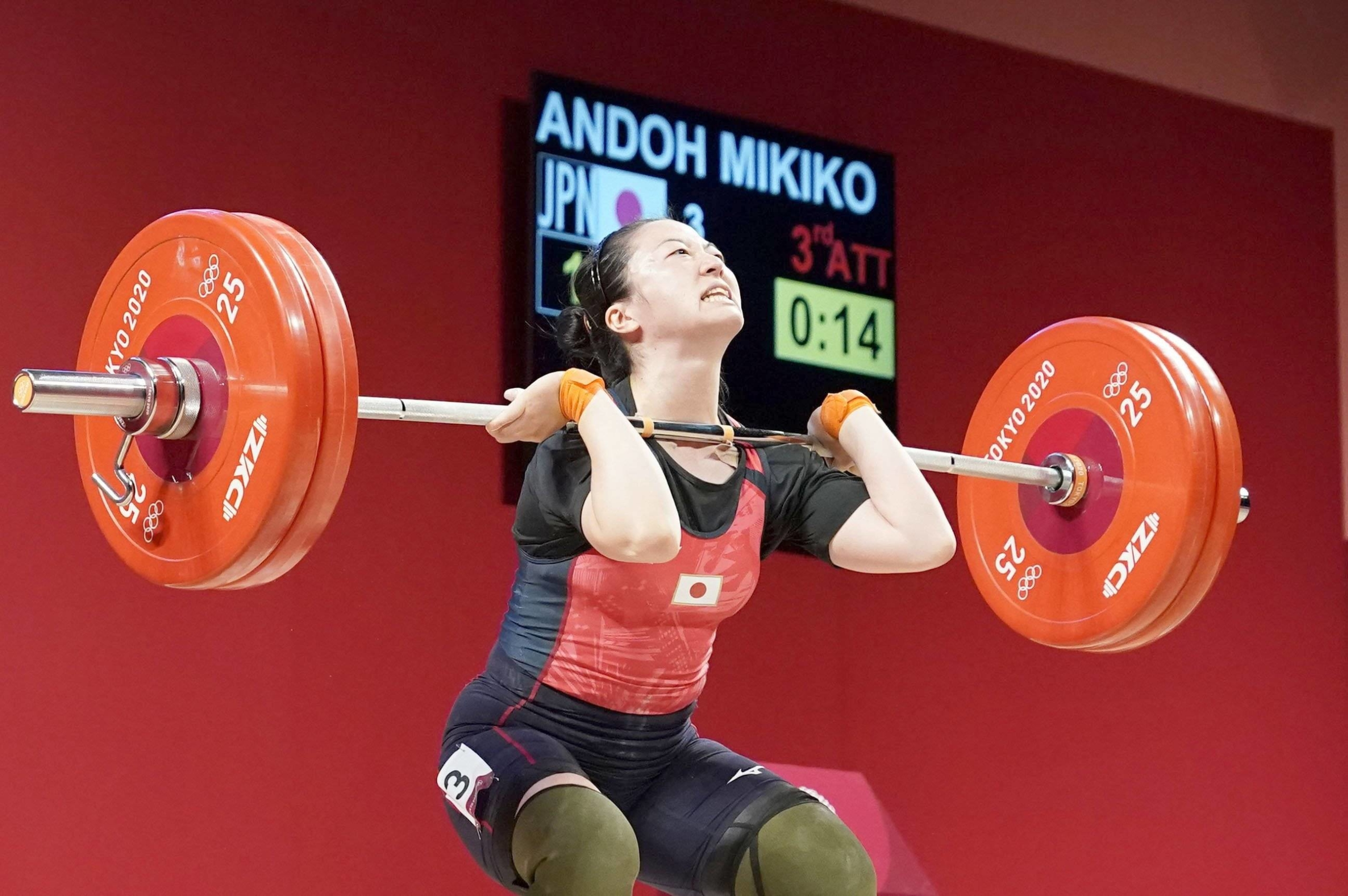 Ando lifted 120 kg in her final jerk attempt Tuesday to clinch the bronze medal.   KYODO
