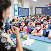 Elementary school students attend class on the first day of the new semester in Wuhan, China, in September 2020.   GETTY IMAGES / VIA BLOOMBERG