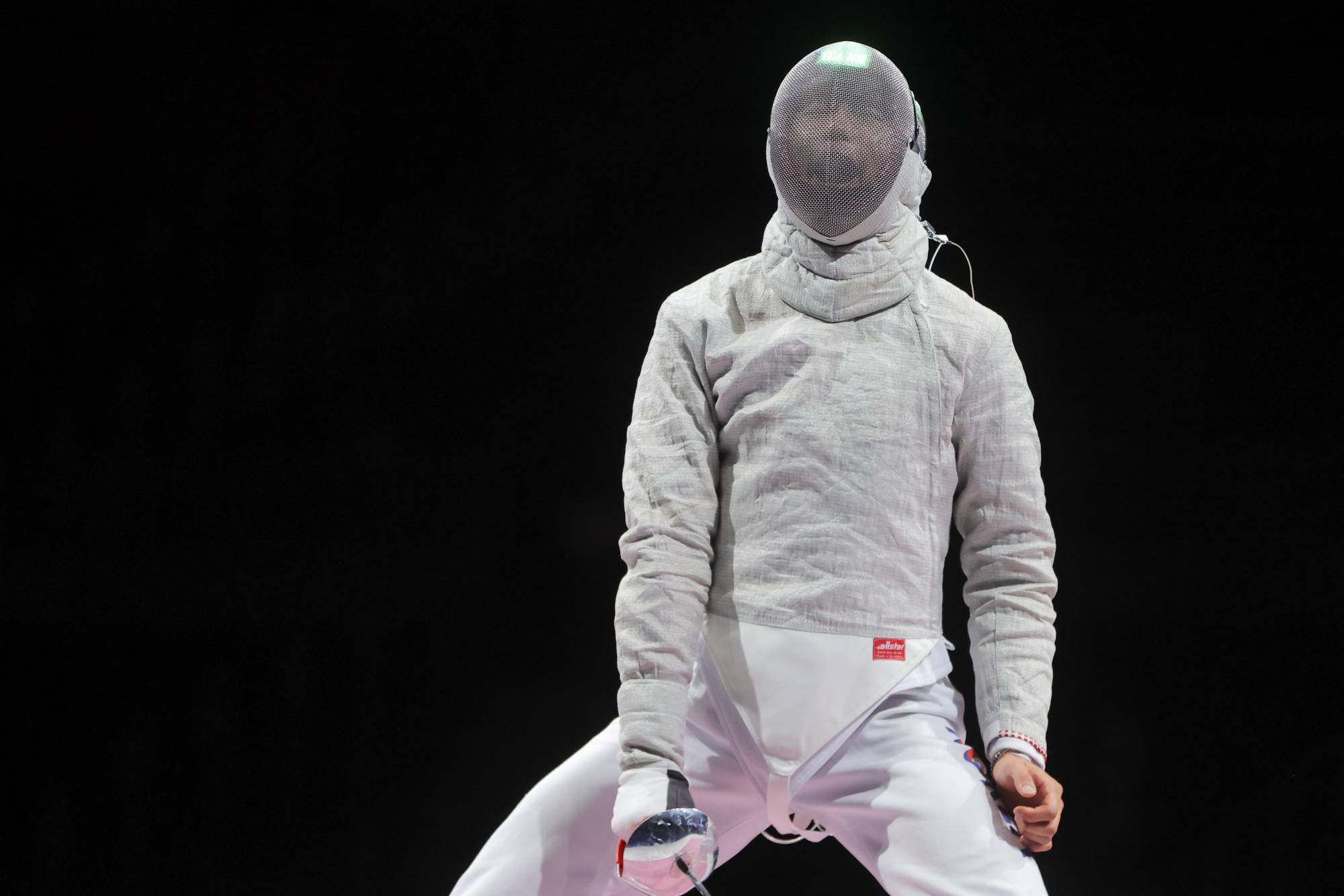 South Korean sabre fencer Oh Sanguk, who was hospitalized for a month with the virus, faded in his quarterfinal against Georgian Sandro Bazadze, eventually losing 15-13. | REUTERS
