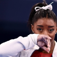 American star Simone Biles reminded us of the hidden mental injuries athletes suffer when she pulled out of the team gymnastics competition this week at the Tokyo 2020 Olympic Games. | AFP-JIJI