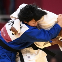 Japan's Shori Hamada competes with France's Madeleine Malonga in the women's gold-medal bout of the under-78 kg class on Thursday.  | AFP-JIJI