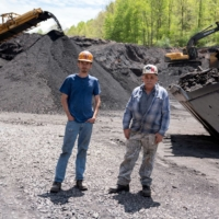 Troy Mullins, 20, and his father, Cosam Mullins, 68, at an Abandoned Mine Land reclamation site where they both operate heavy equipment in Clinchco, Virginia. | REUTERS