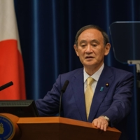 Prime Minister Yoshihide Suga speaks during a news conference in Tokyo on July 8.   BLOOMBERG