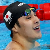 Daiya Seto reacts after qualifying for the men's 200-meter individual medley final on Thursday at the Tokyo Aquatics Centre. | REUTERS