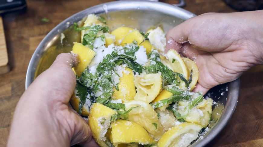 Add the lemon rind and shiso leaves to a bowl. Pour in the sugar, and mix with your hands or a large spoon for maximum coverage.   ALEX FISHER