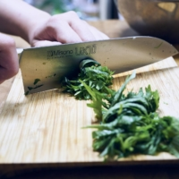 Roll the shiso leaves together and finely slice them into thin strips.   ALEX FISHER