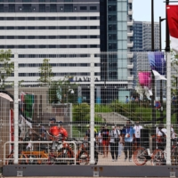 The athletes village and Olympic press center represent a huge, strict COVID-19 control zone for the more than 50,000 competitors, coaches, staff and journalists.  | REUTERS