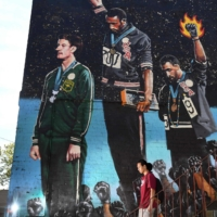 A giant mural depicting a protest by U.S. sprinters Tommie Smith and John Carlos at the 1968 Mexico City Games.    AFP-JIJI