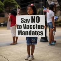 Anti-vaccine protesters in Houston, Texas, on June 26   AFP-JIJI