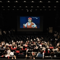 Fans gather for a public viewing of the Japan-U.S. Olympic softball game at Takasaki City Theatre in Takasaki, Gunma Prefecture, on Tuesday.  | AFP-JIJI