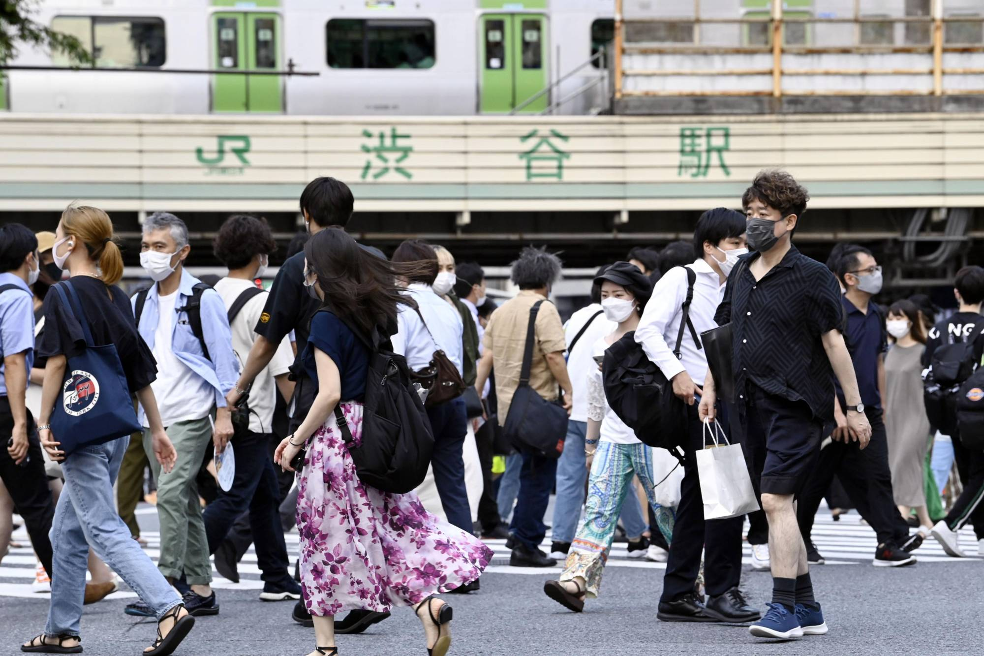 Crowded streets near Tokyo's Shibuya Station on Thursday, despite rising COVID-19 numbers | KYODO