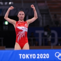 Trampoline gold medalist Zhu Xueying of China reacts after completing her routine.  | REUTERS