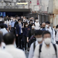 Osaka's Umeda district on Thursday afternoon. Osaka Prefecture will be under a state of emergency from Monday. | KYODO