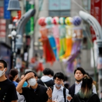 People at the Shibuya crossing in Tokyo on Thursday  | REUTERS