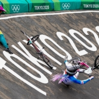 Lauren Reynolds of Australia and Axelle Etienne of France crash during's women's BMX action on Friday.  | REUTERS