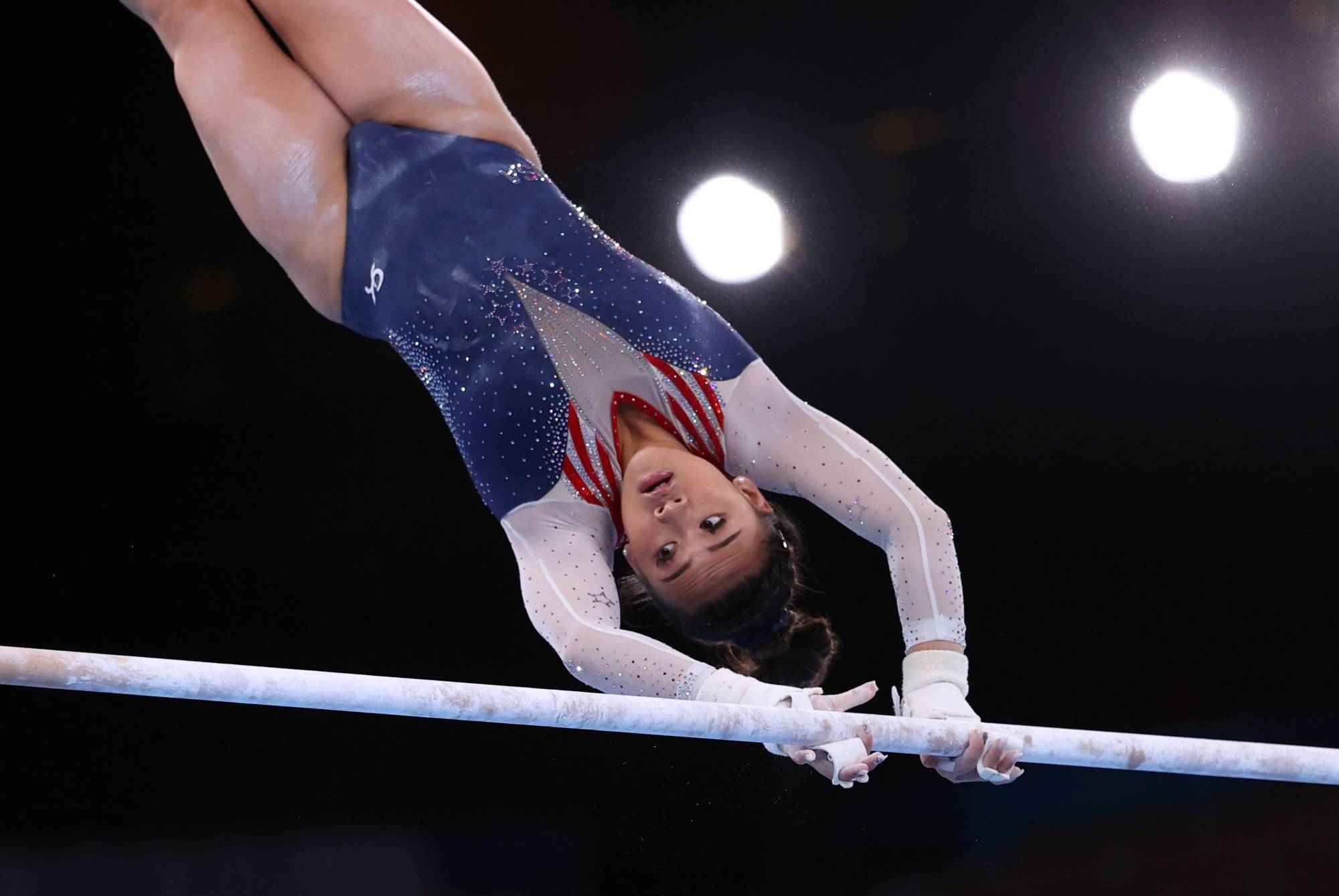 Gymnast Sunisa Lee of the United States in action on the uneven bars on Thursday. | REUTERS