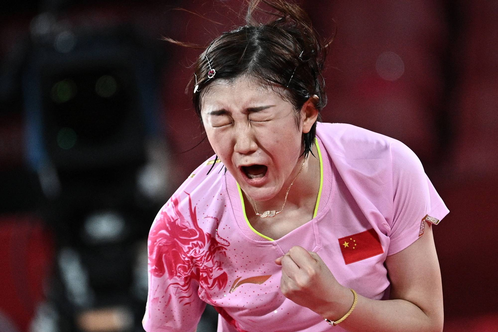 China's Chen Meng reacts after defeating China's Sun Yingsha during the women's singles table tennis final match. | AFP-JIJI