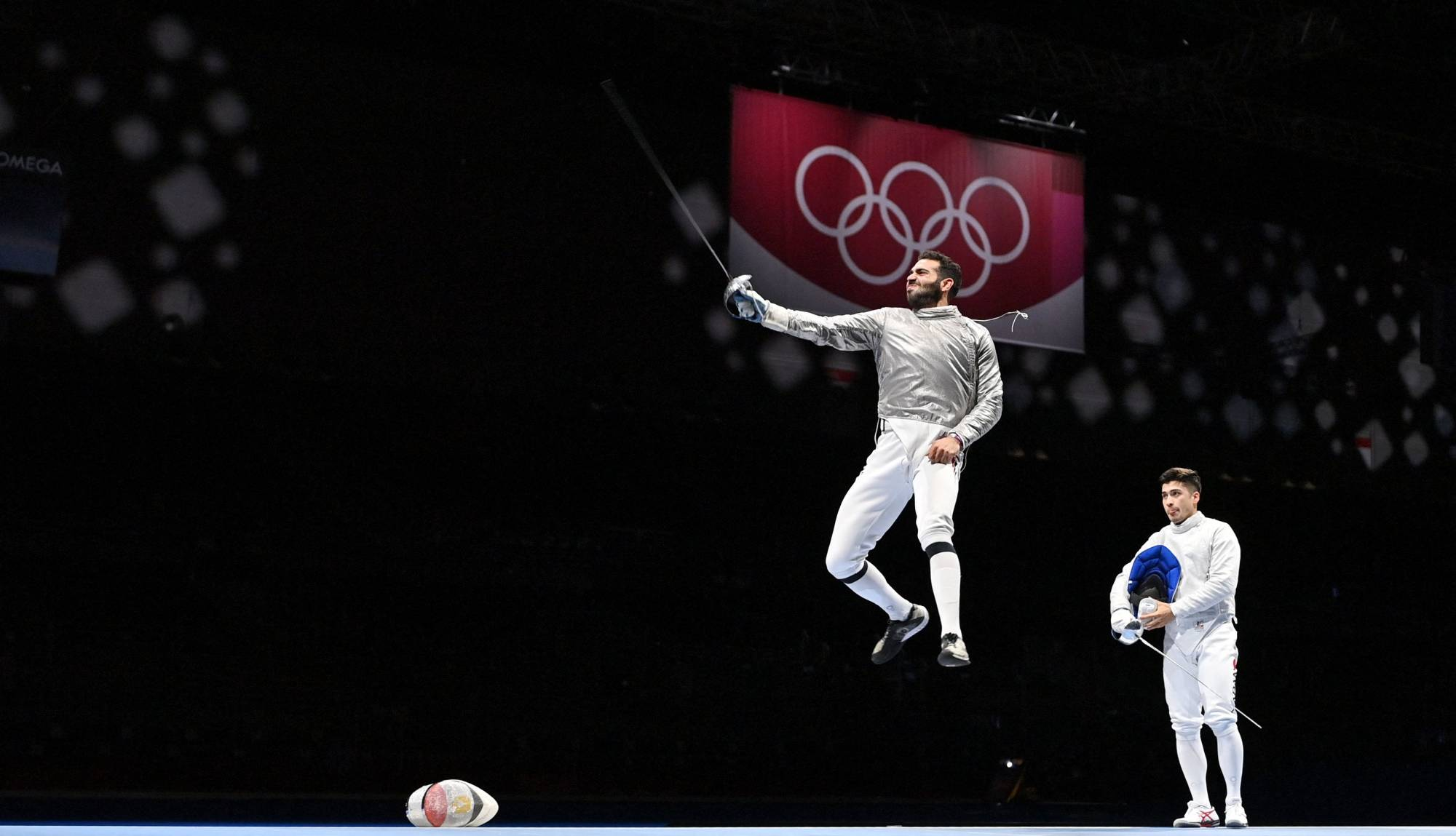 Egypt's Ziad Elsissy (left) celebrates scoring the final point against Japan's Kaito Streets in the men's sabre team qualifying bout. | AFP-JIJI