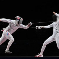 Russian Sergey Bida (left) competes against Japan's Uyama Satoru in the men's epee team gold medal match at the Makuhari Messe Hall in Chiba. | AFP-JIJI