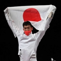 Japan's men's epee team celebrates after winning gold at Makuhari Messe Hall in Chiba on Friday.  | AFP-JIJI
