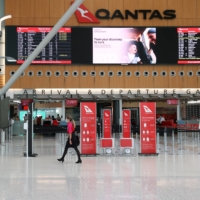 An empty terminal at Sydney Airport. The Australia Prime Minister plans to keep the border closed until domestic vaccinations reach 80%. | REUTERS