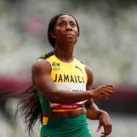 Sprinter Shelly-Ann Fraser-Pryce of Jamaica finishes first in her 100-meter heat on Friday.  | REUTERS