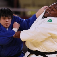 Japan's Akira Sone (blue) and Cuba's Idalys Ortiz compete in the women's over-78 kg gold medal bout at Tokyo's Nippon Budokan on Friday.  | AFP-JIJI