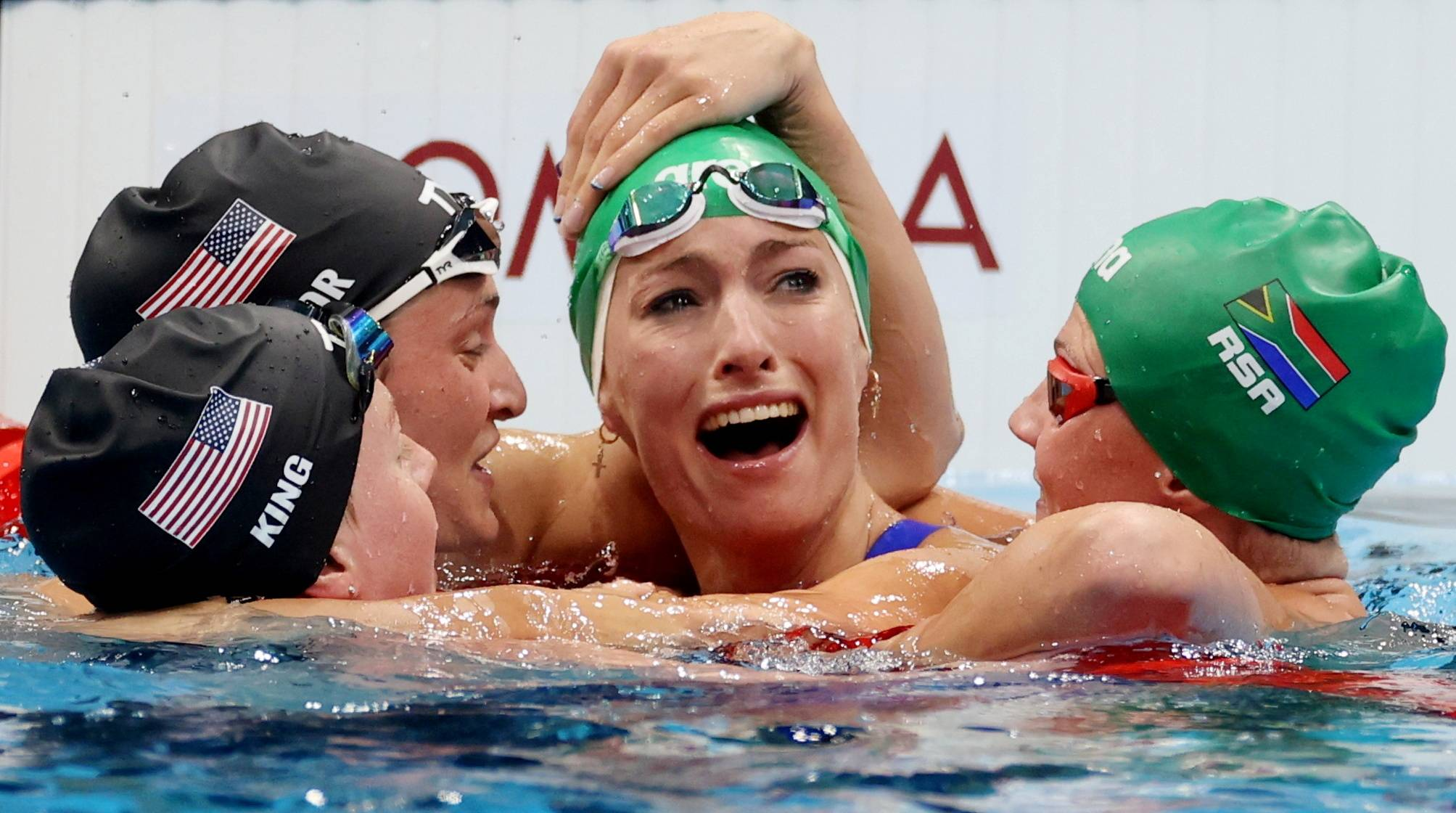 Swimmers in the women's 200-meter breaststroke congratulate South Africa's Tatjana Schoenmaker for setting a new world record. | REUTERS