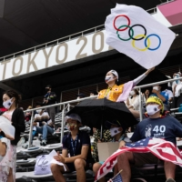 As Olympic fever hits Japan, virus threat looms ominously