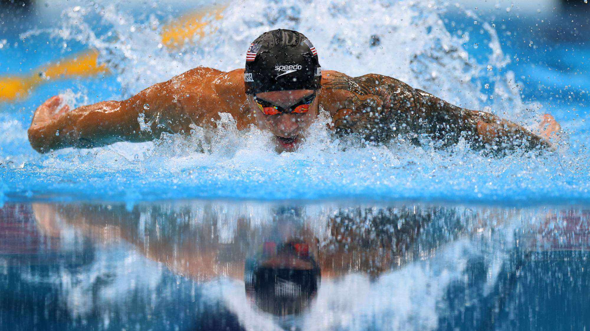 American Caeleb Dressel stormed to the men's 100 meter butterfly gold medal on Saturday with a world record time of 49.45 to pick up his second individual gold of the Tokyo Games. | REUTERS