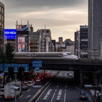 A shinkansen train travels through Tokyo's Shimbashi area. An explosive resurgence of COVID-19 nationwide is weighing heavily on the tourism industry.