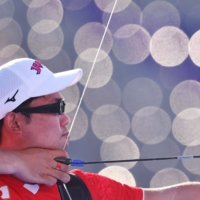 Takaharu Furukawa of Japan in action in the bronze medal match of the men's individual archery competition on Saturday at Yumenoshima Archery Field.  | REUTERS