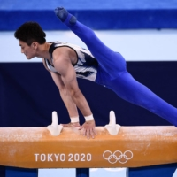 Kohei Kameyama competes in the pommel horse event at Ariake Gymnastics Centre on July 24.    AFP-JIJI