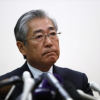 Japanese Olympic Committee President Tsunekazu Takeda faces reporters at a news conference in Tokyo in January 2019.   REUTERS