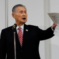 Yoshiro Mori, head of the Tokyo Olympic organizing committee, apologizes  at a news conference in February for making sexist remarks.   POOL / VIA REUTERS